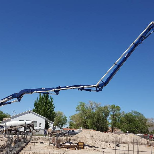 Concrete pump boom extended over rebar forest