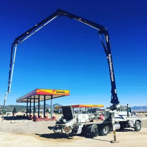 Concrete boom extended for slab pour at Love's gas station