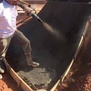 Worker holding hose blasting shotcrete