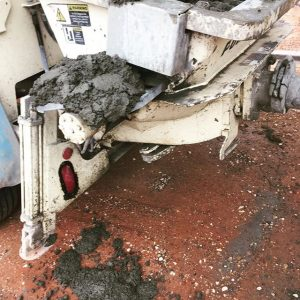 Concrete mess on equipment outside the hopper