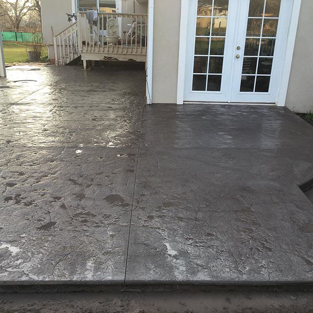 View of beautiful stamped concrete patio after completion