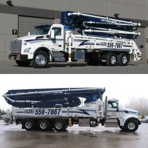 Picture of two brand new pumper trucks
