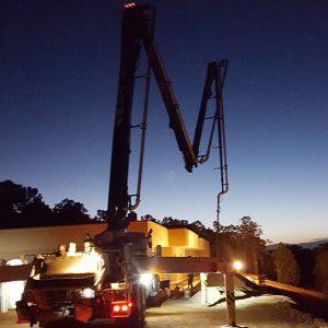Pouring concrete at sunrise