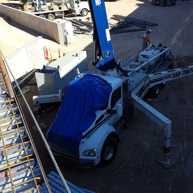 Truck with outriggers extended and boom raised