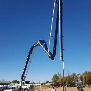 Concrete boom pouring house foundation
