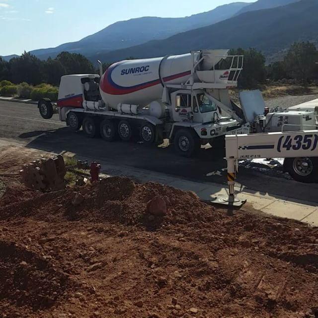 Sunroc truck pouring concrete into the hopper