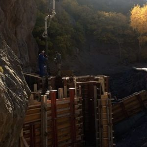 Pouring into precarious canyon spot