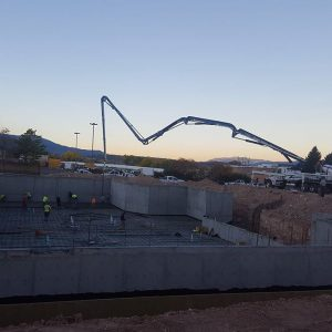 Boom extended to pour large basement slab of commercial building