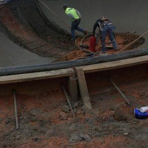 Workers blasting shotcrete for skate park walls