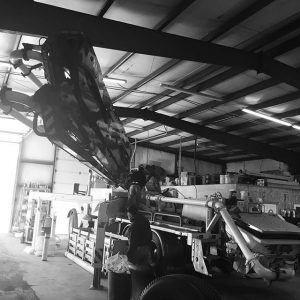 Worker doing truck maintenance at the shop