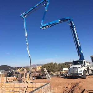 Truck pouring another foundation wall