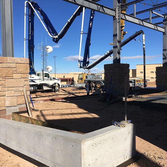 Boom reaching for tight fit between steel girders
