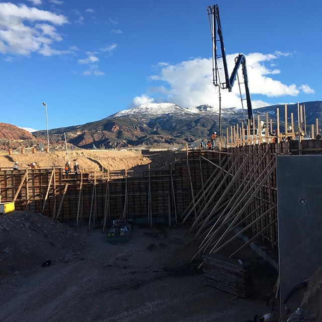 Boom extending over a large foundation wall