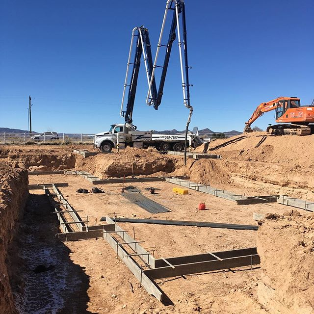 Boom extended for footing pour - waiting for concrete truck