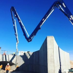 Boom extended to pour slab in front of large culvert