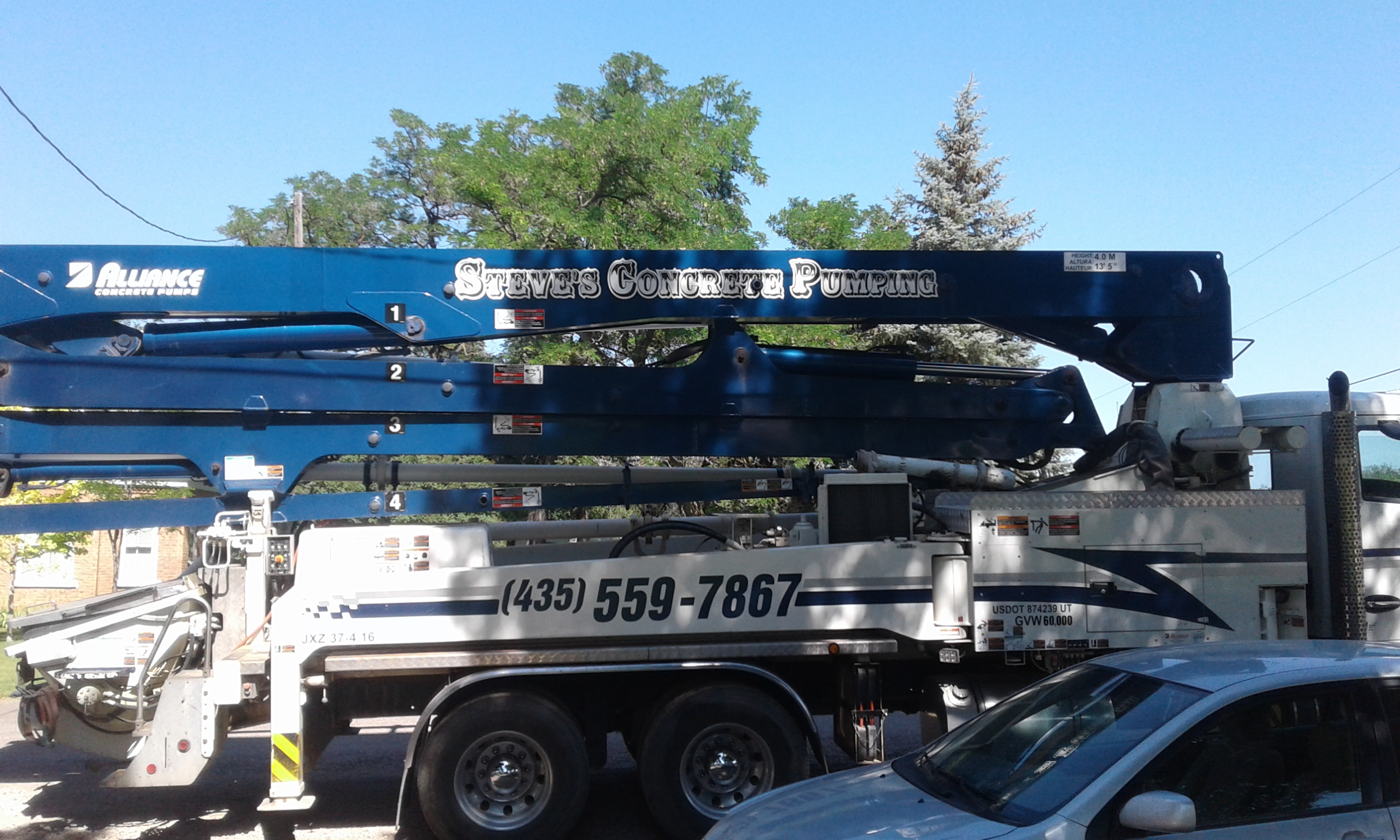 Side view of one of our concrete pumper trucks